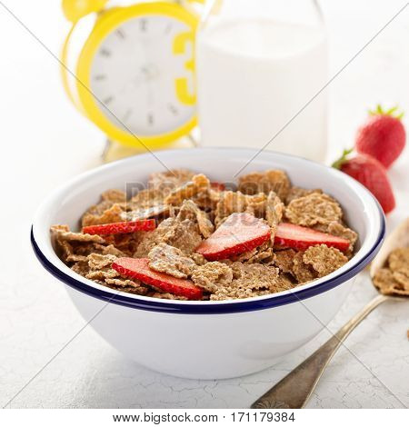 Multigrain wholewheat healthy cereals with fresh berry for breakfast on white table