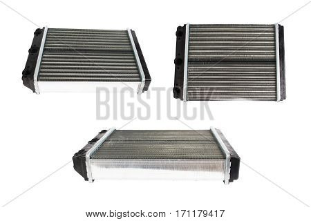 Many engine cooling radiators isolated on white background. Auto spare parts for passenger car.