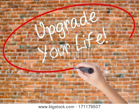 Woman Hand Writing Upgrade Your Life!  With Black Marker On Visual Screen