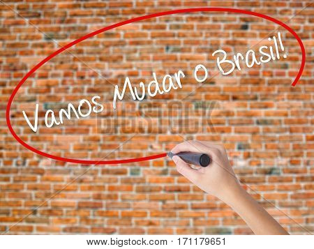 Woman Hand Writing Vamos Mudar O Brasil! (let's Change Brazil In Portuguese)  With Black Marker On V