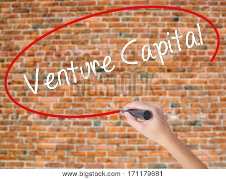 Woman Hand Writing Venture Capital With Black Marker On Visual Screen