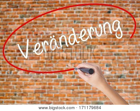 Woman Hand Writing Veranderung  (change In German) With Black Marker On Visual Screen