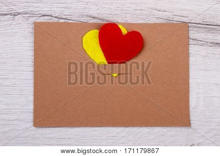 Card and hearts. Greeting card on wooden plank. Simple handmade for holiday. Write all your wishes.