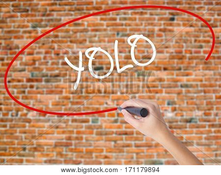 Woman Hand Writing Yolo (you Only Live Once) With Black Marker On Visual Screen