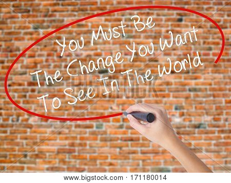 Woman Hand Writing You Must Be The Change You Want To See In The World With Black Marker On Visual S