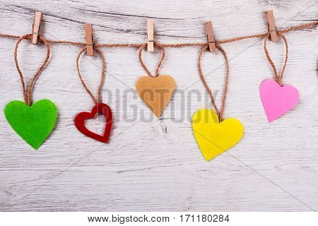 Fabric hearts pinned to rope. Wooden clothespins on twine. How to make cute decoration. Great romantic atmosphere.