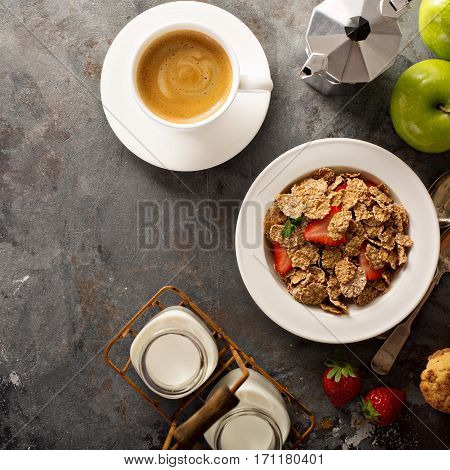 Multigrain wholewheat healthy cereals with fresh strawberryfor breakfast with copyspace overhead shot