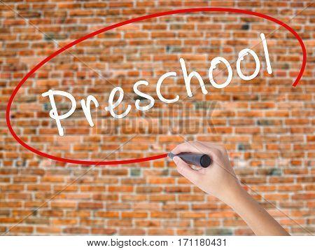 Woman Hand Writing Preschool With Black Marker On Visual Screen