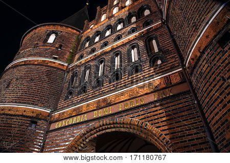 Holstentor in Luebeck at night detail of the medieval city gate a popular tourist attraction of the historic old town in Schleswig-Holstein Germany