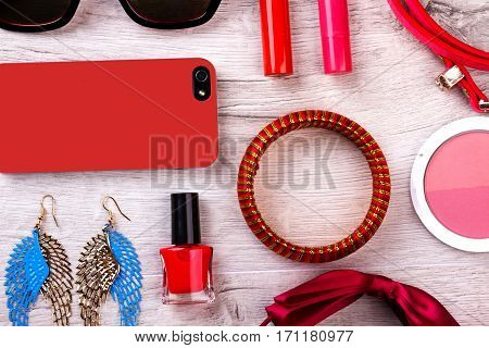Makeup kit and accessories. Cell phone and sunglasses. Small details for great look. Beauty is style of life.