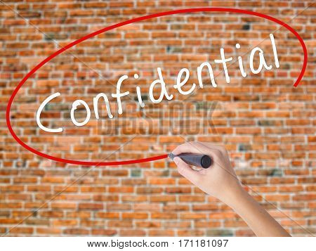 Woman Hand Writing Confidential With Black Marker On Visual Screen