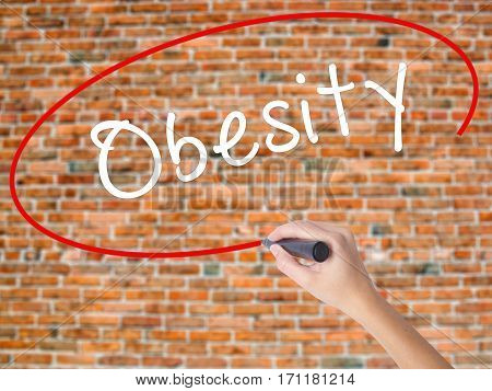 Woman Hand Writing Obesity With Black Marker On Visual Screen