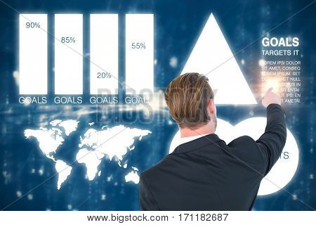 Rear view of young businessman in suit pointing against digitally generated image of abstract pattern