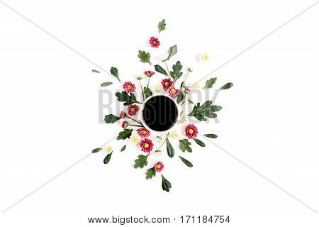 Coffee cup and wildflowers composition on white background. Flat lay top view. Flowers composition.