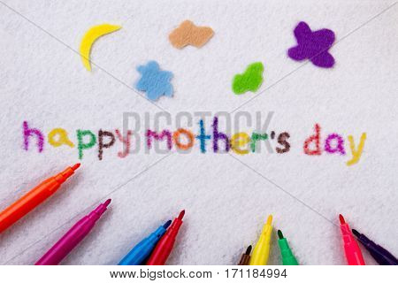 Happy Mother's Day inscription. Felt-tip pen on cloth background. Congratulate mother with present. Make it colorful.