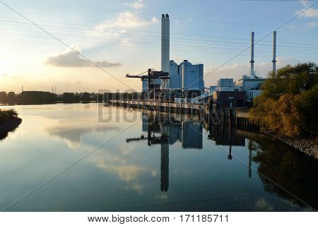 Coal power plant r on the side of a Canal, Germany.