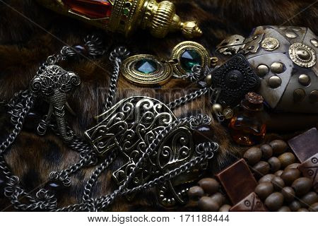 necklaces and bracelets with precious stones on the skin of the beast