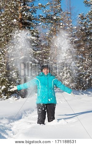 Nerungry Neryungry District Yakutia Russia. February 5 2017 Woman throws up snow in the winter forest