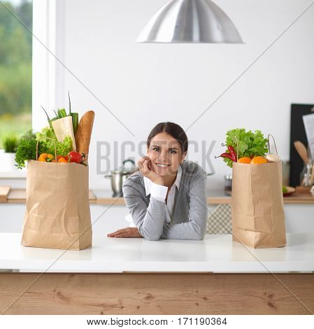 Portrait of a smiling woman cooking in her kitchen