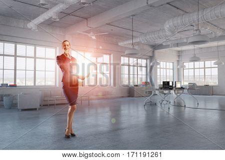 Elegant businesswoman thinking something over . Mixed media