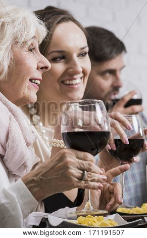 Happy Mother And Daughter Drinking Wine