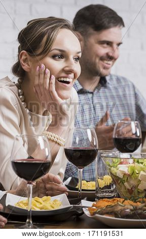 Smiling Couple Sitting At The Table