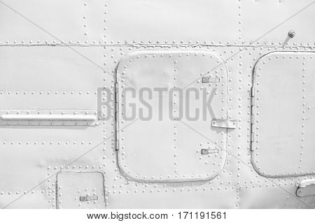 Aircraft metal plating texture with rivets background.