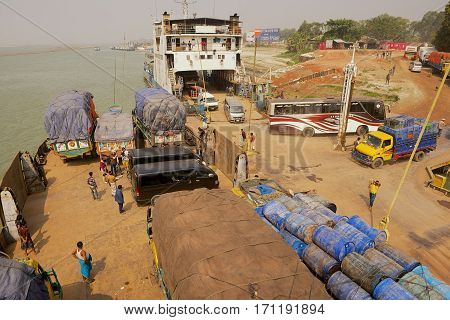 CHHOTA DHULANDI, BANGLADESH - FEBRUARY 19, 2014: Unidentified ferry staff and passengers present at unloading Daulatdia ferry boats at Ganga river bank in Chhota Dhulandi, Bangladesh. Ferry is a very important way of transportation in Bangladesh.