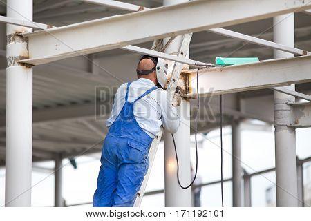 Worker Welding Beams
