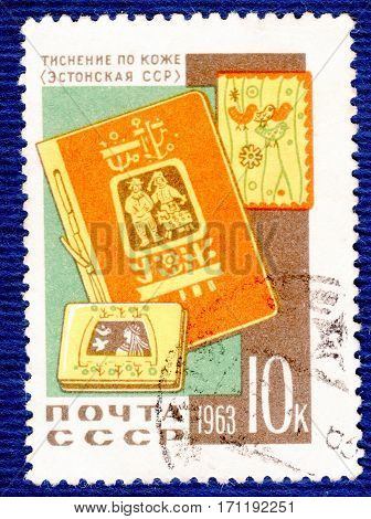 USSR - CIRCA 1963: Postage stamp printed in USSR with a picture a stamping on a skin (Estonian SSR) a cover, notebook and book, from the series