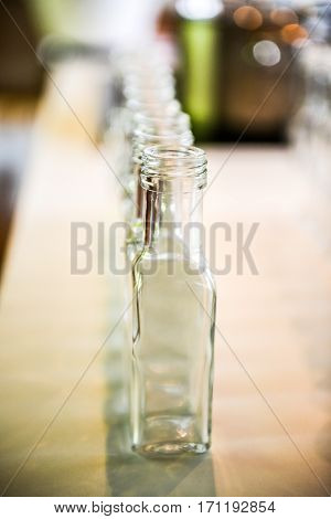 Set Of Small Transparent Plastic Bottles Ready To Be Filled.