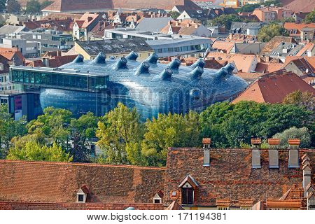 GRAZ/ AUSTRIA - OCTOBER 8, 2016: City overview from the hill Schlossberg with the Art Museum Kunsthaus (called also as Friendly Alien) in the middle. Graz, Austria.