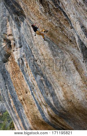 Extreme sport climbing. Rock climber struggle for success. Outdoor lifestyle.