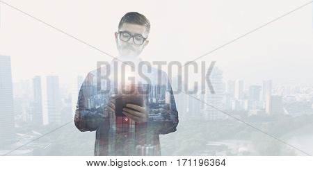 Hipster guy use smartphone . Mixed media