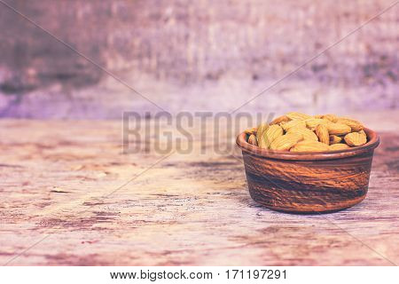 Almonds In A Bowl On The Old Wooden Background.