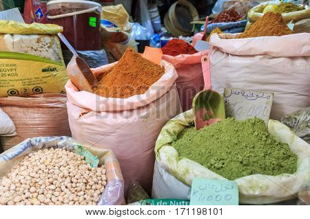 Oriental marketplace with sacks full nuts, spices and seeds