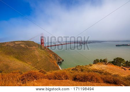 Golden Gate Bridge from Marina's Vista Point at sunset, north shore, Mill Valley, San Francisco Bay, California. Fog in the summertime. Symbol and icon of San Francisco. American travel concept.