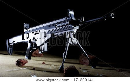 Semi automatic assault rifle in the dark on a bipod