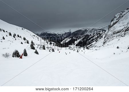 Panoramic View Down A Mountain Valley With Overcast Sky