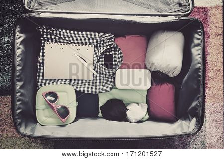 Travel Accessories In A Suitcase. Vintage Toned