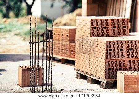 Industrial Construction Site, Reinforcement Of Steel Bars, Wooden Boards And Brick Stacks