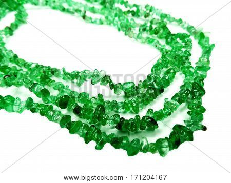 emerald gemstone beads isolated on white background