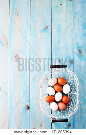 blue background with basket of eggs - Easter time