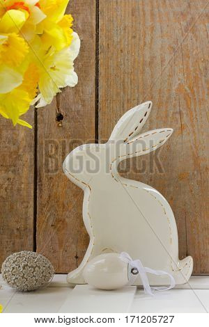 Easter eggs hunt - white rabbit with eggs