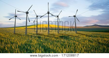 Windmills side by side against white background against scenic view of wheat field