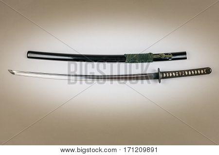 Japanese sword isolated on white. Iaido training sword iaito. Studio shot white light in center.