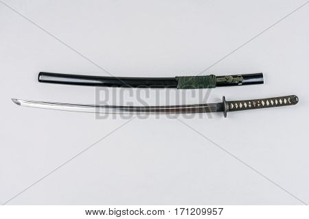 Japanese sword isolated on white. Iaido training sword iaito.