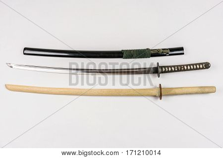Japanese training swords for iaido and kendo, steel and wood. Studio shot.