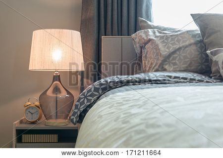 Classic Lamp Style With Alarm Clock On Table Side In Cozy Bedroom