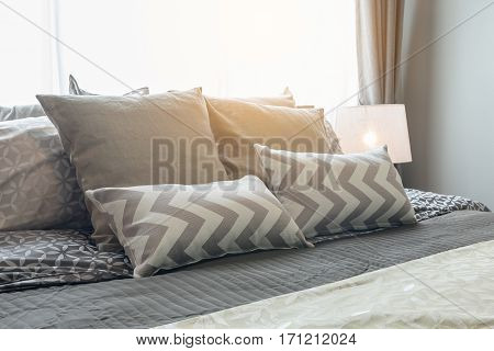 Set Of Pillows On Bed In Cozy Bedroom
